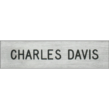 Plastic silver name plate.